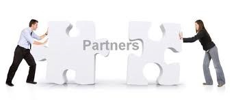 image of two puzzle pieces being pushed together to form the word partners